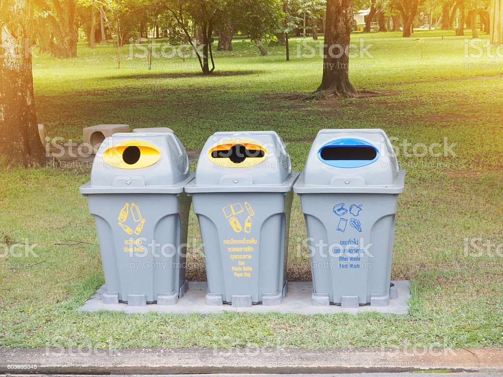 recycle bins in the park stock photo
