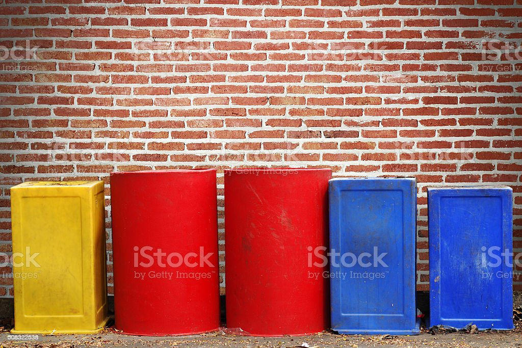 Recycle bins with brick wall background stock photo