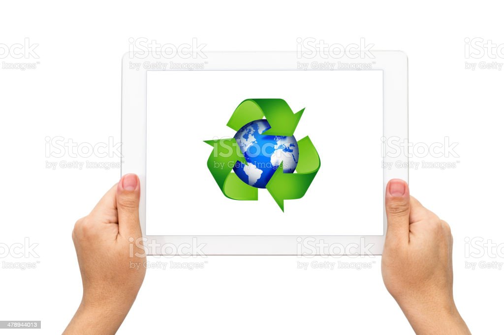 Recycle Earth symbol with holding tablet stock photo