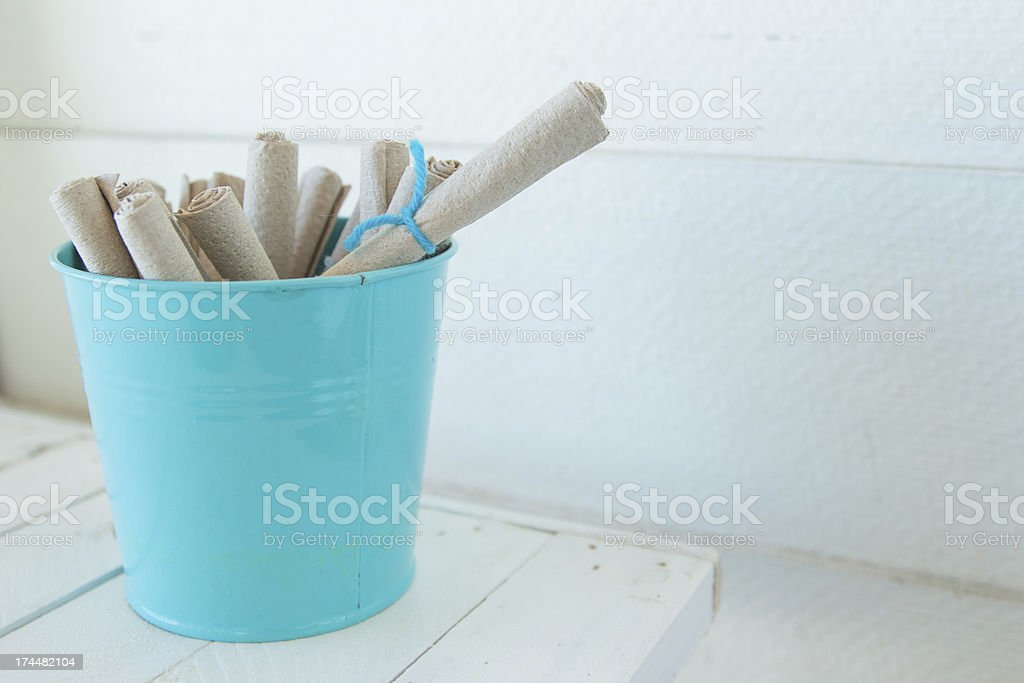 Recycle napkin and blue cup in white room stock photo