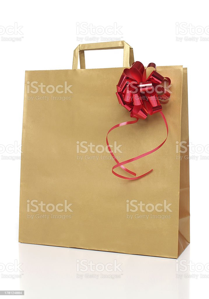 Recycle shopping brown bag with red ribbon royalty-free stock photo