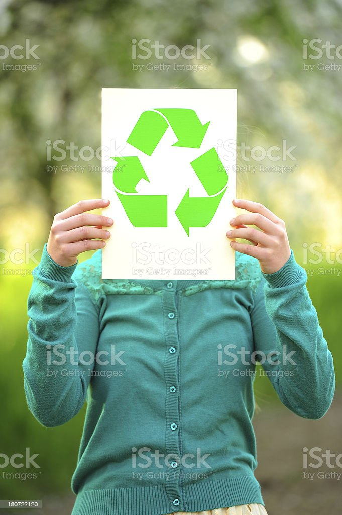 Recycle sign in front of face royalty-free stock photo