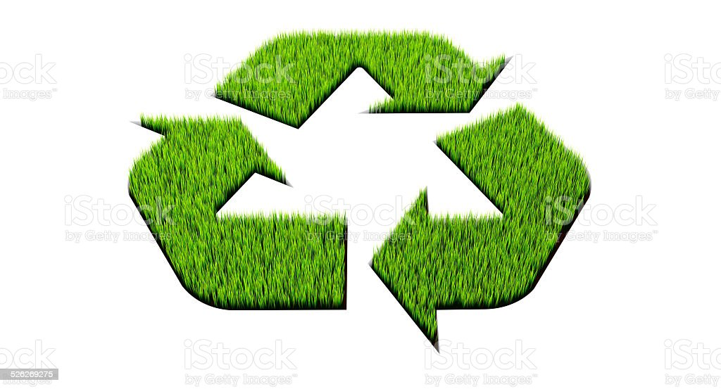 Recycle symbol cut out of grass stock photo