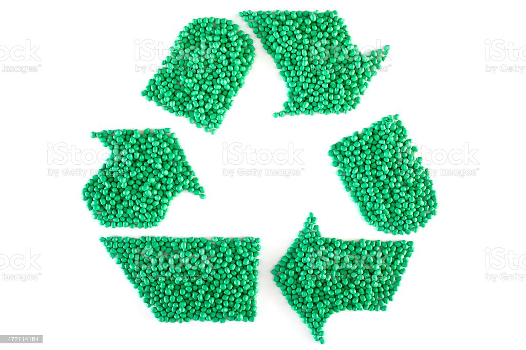 Recycle symbol made up of green plastic resin pellets stock photo