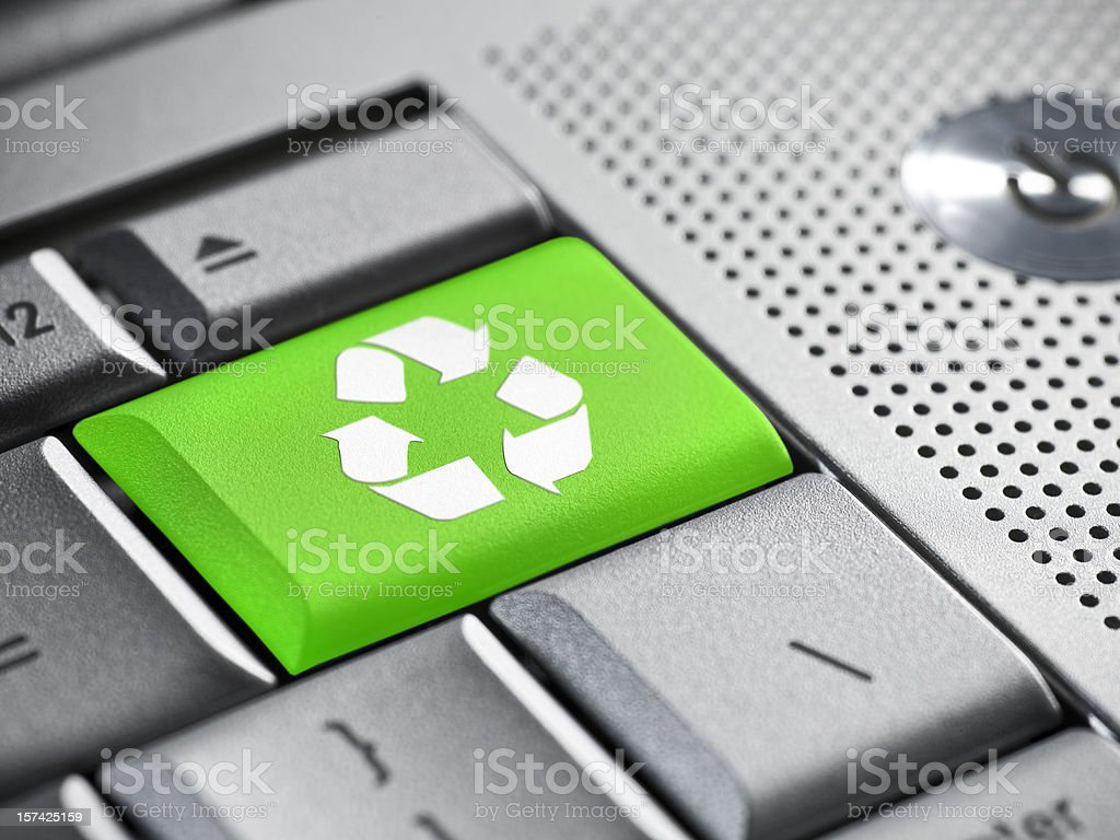 Recycle symbol on a laptop keyboard royalty-free stock photo