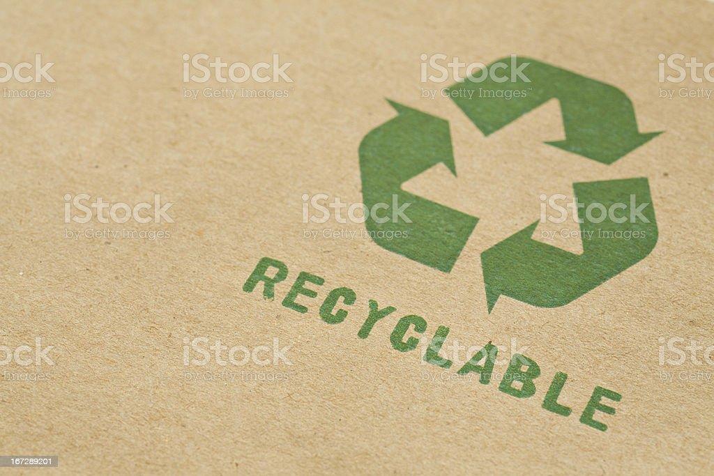 Recycle symbol on cardboard stock photo