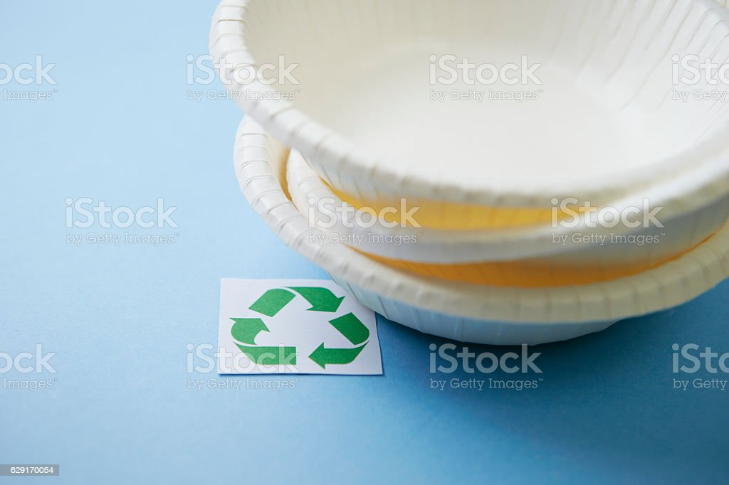 Recycle symbol with paper plates stock photo