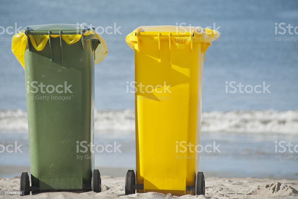 Recycle trash containers in the beach stock photo