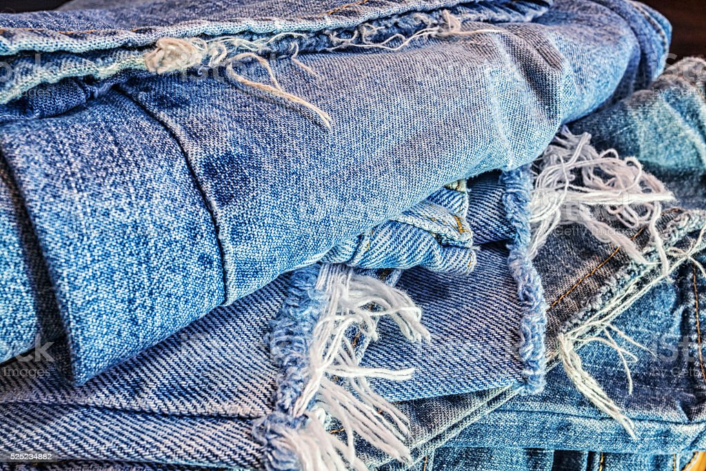Recycled Heap Of Ragged Old Blue Jeans stock photo