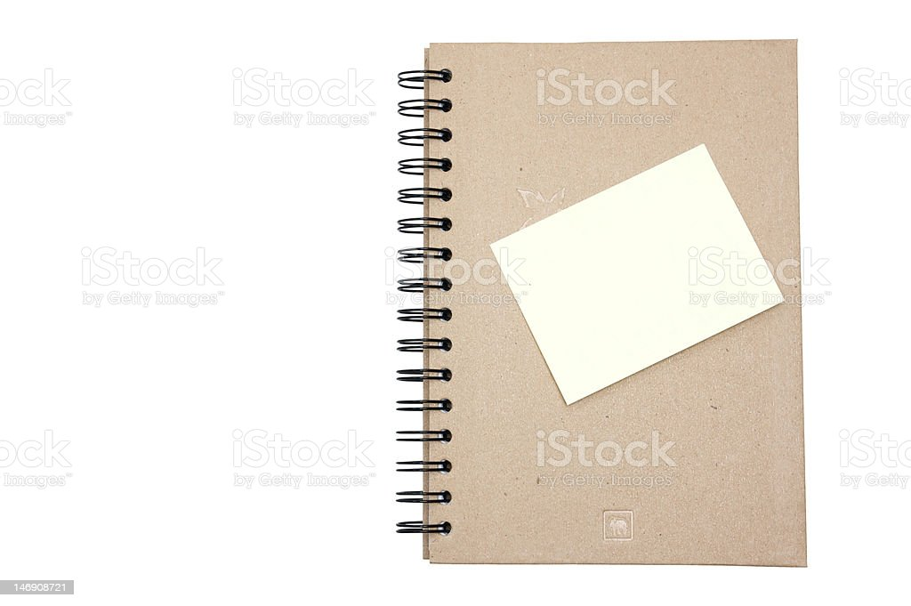 Recycled paper notebook hard cover with yellow reminder royalty-free stock photo