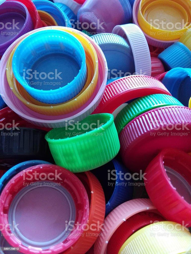 Recycled plastic bottle caps stock photo