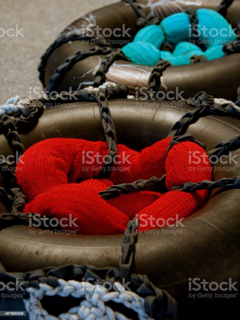 Recycled tyres and knitwear royalty-free stock photo
