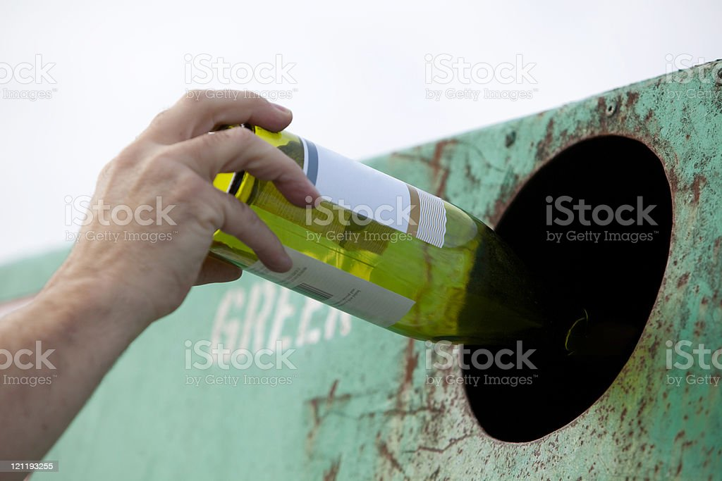 Recycling a bottle stock photo