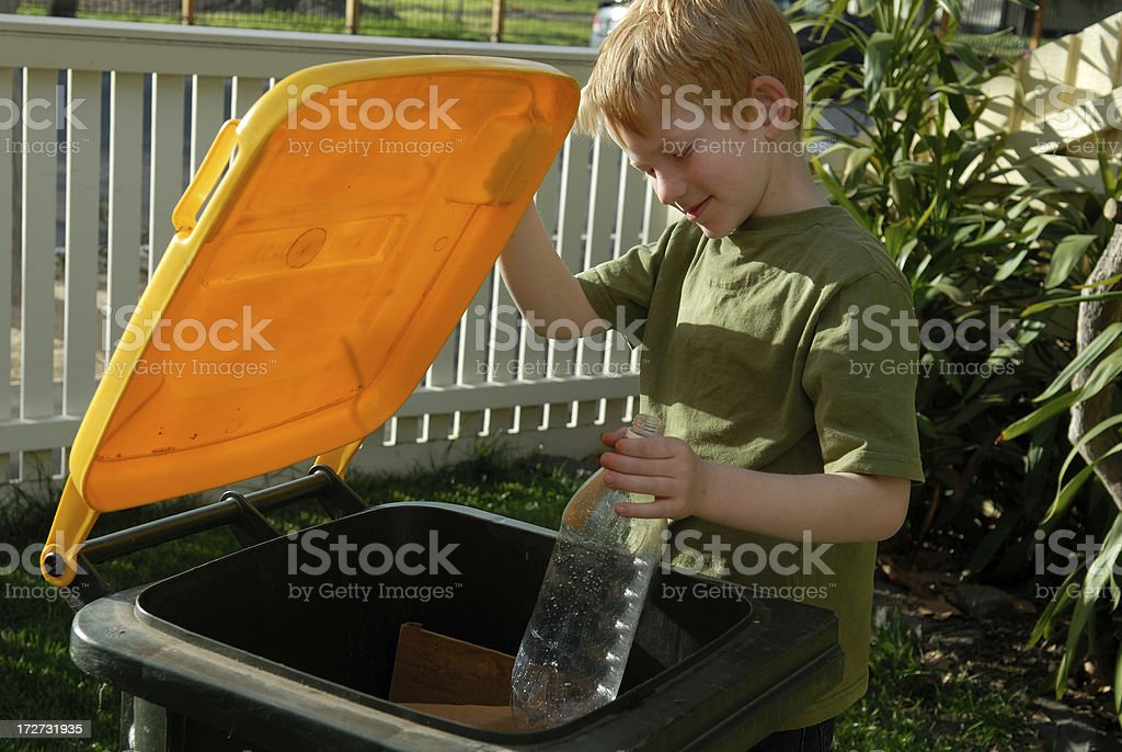 Recycling a drink bottle royalty-free stock photo