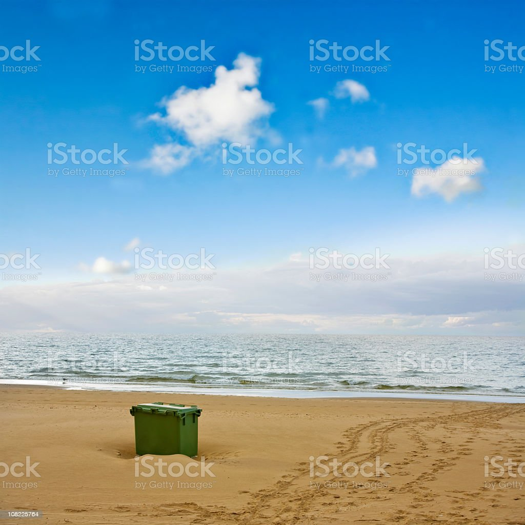 Recycling Bin on Beach with Blue Sky Background royalty-free stock photo