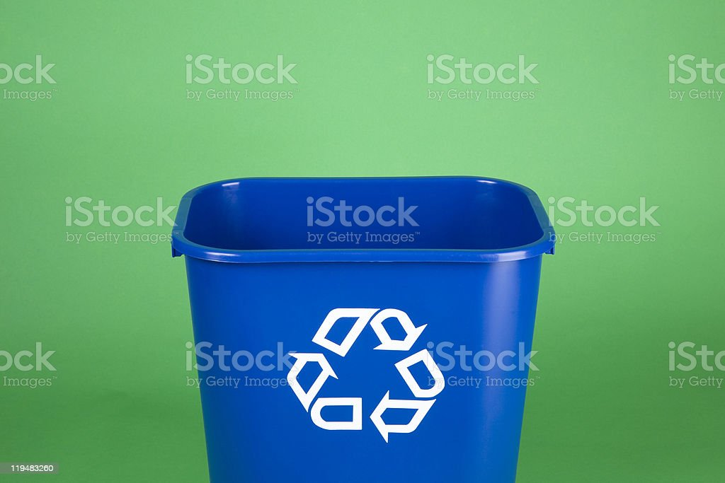 Recycling bin on green background with copy space stock photo