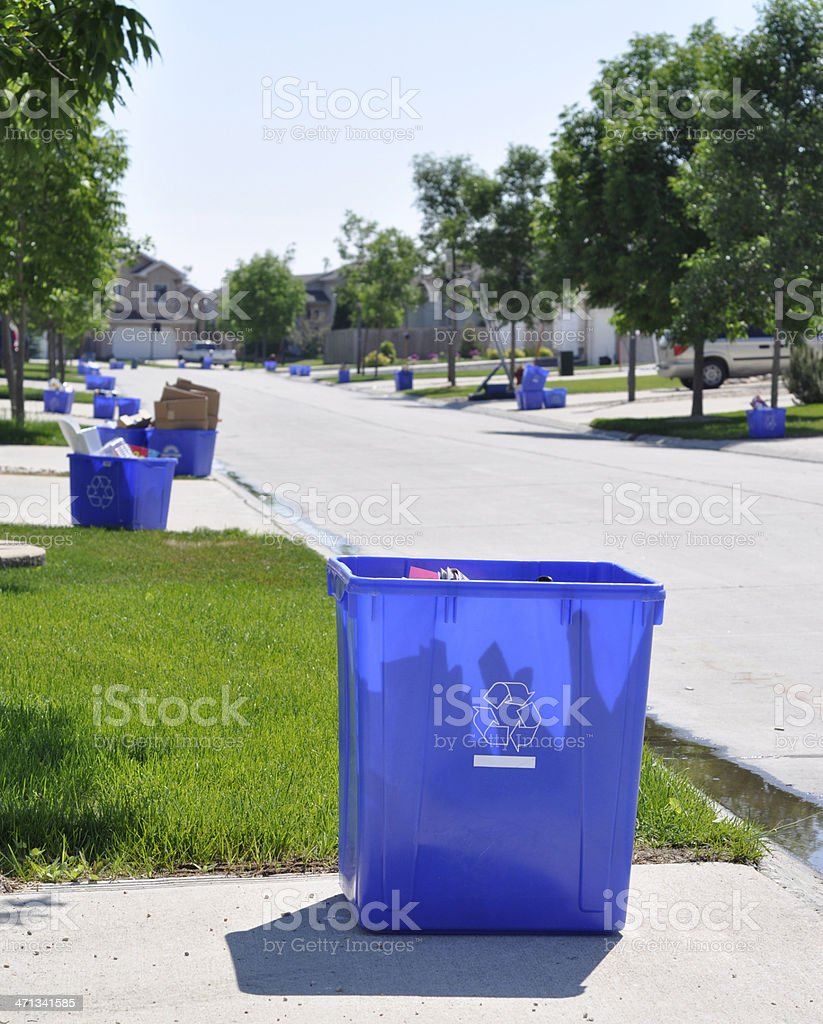 recycling bin on green grass stock photo