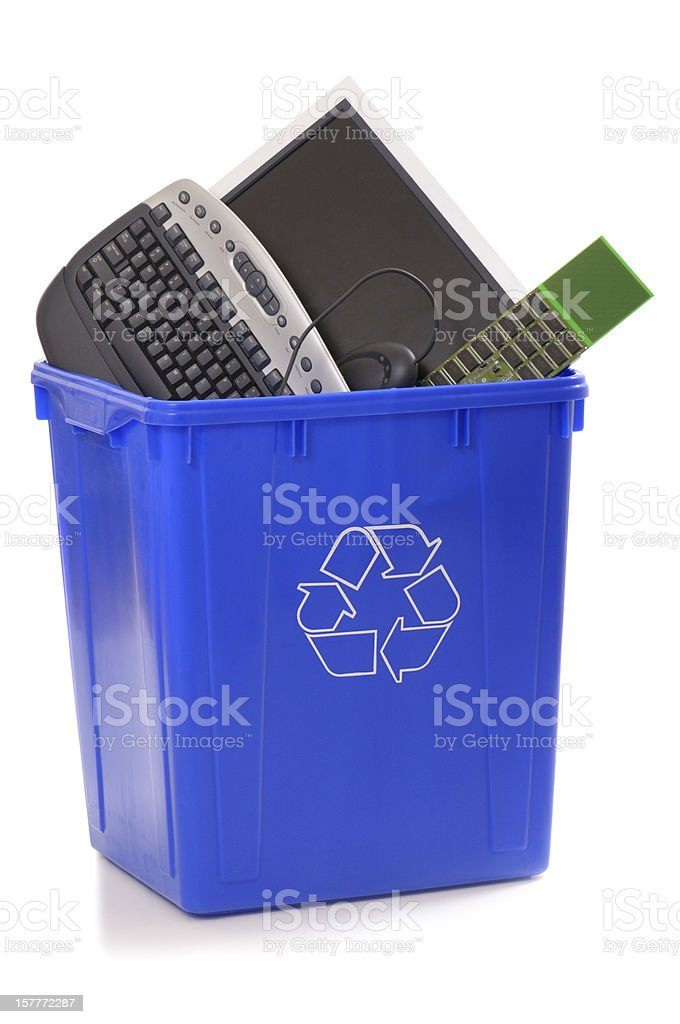 Recycling bin with old computer parts stock photo