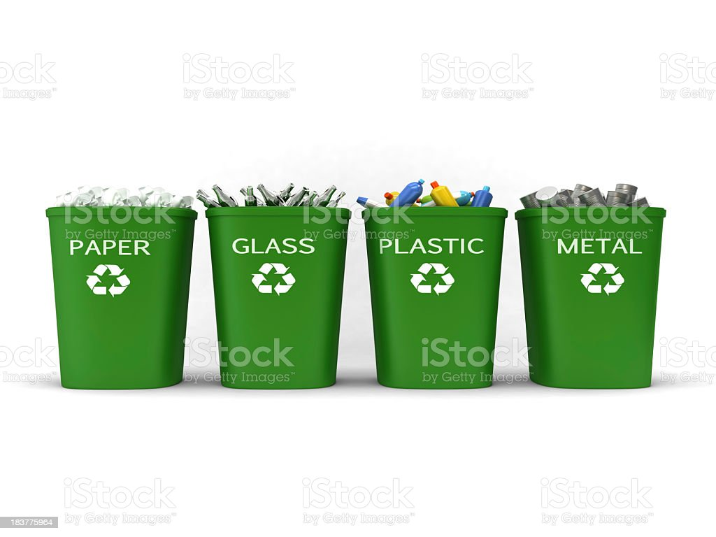 Recycling bins filled with paper, glass, plastic and metal stock photo