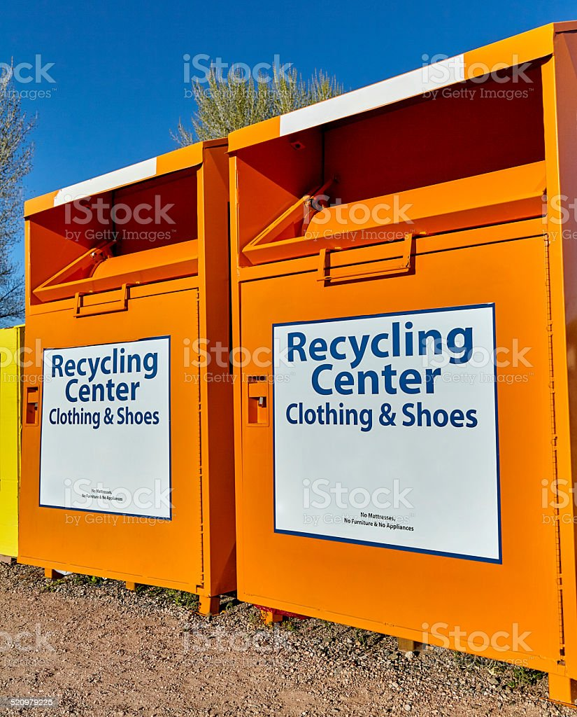 Recycling center collection bins for clothing and waste disposal stock photo