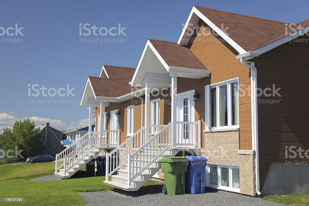 Recycling house with blue and green bins stock photo