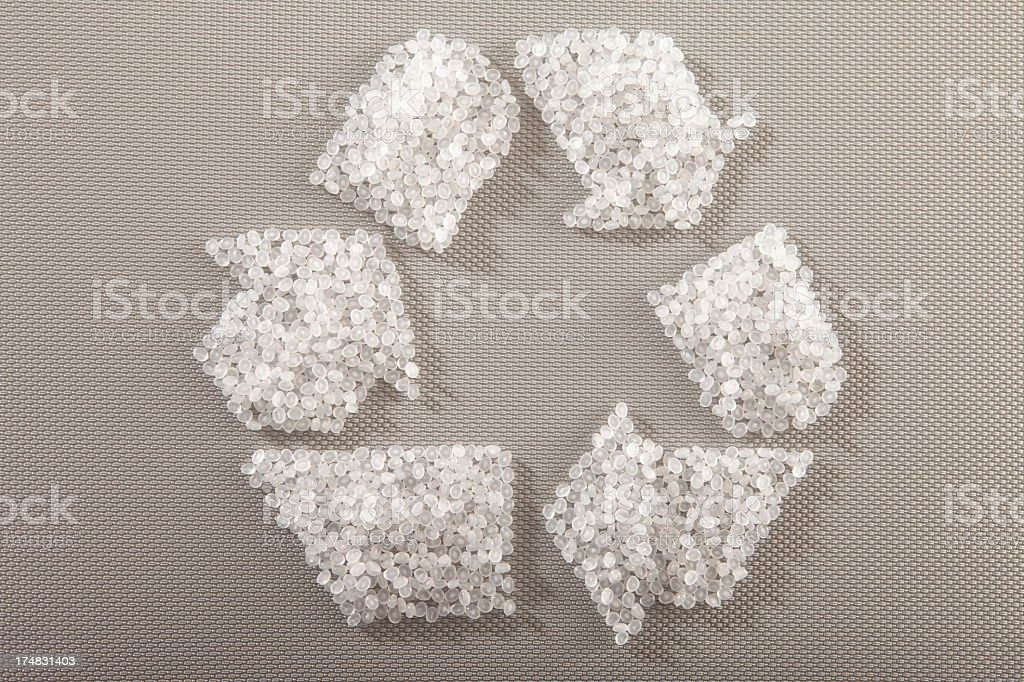 Recycling plastic resin pallets showing a recycle sign stock photo