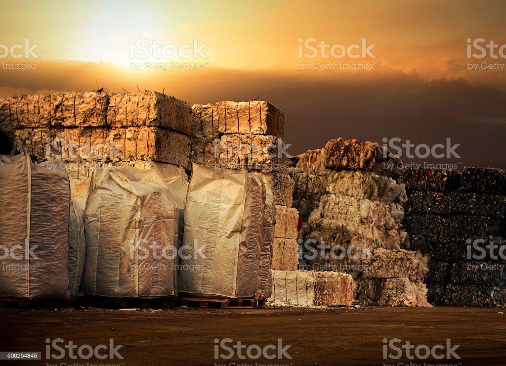 Recycling storage heap outdoors at sun set stock photo