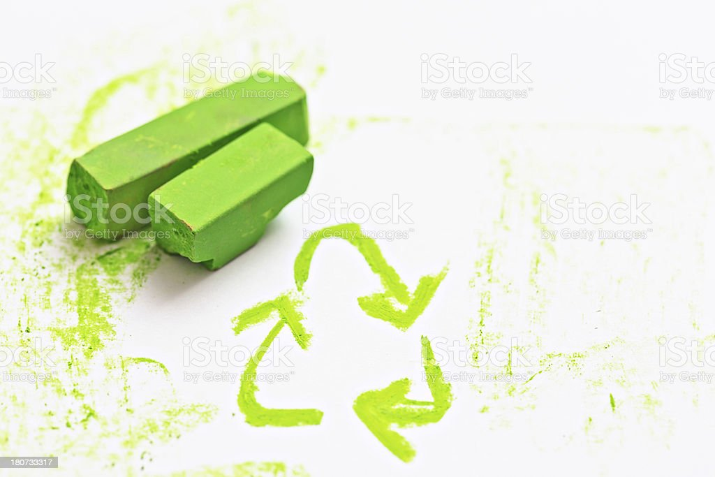 Recycling symbol drawn in lime green pastel on sketchbook royalty-free stock photo