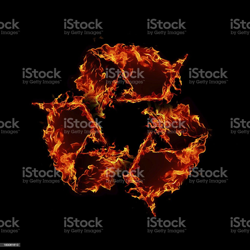 Recycling symbol made of fire flames isolated on black background royalty-free stock photo