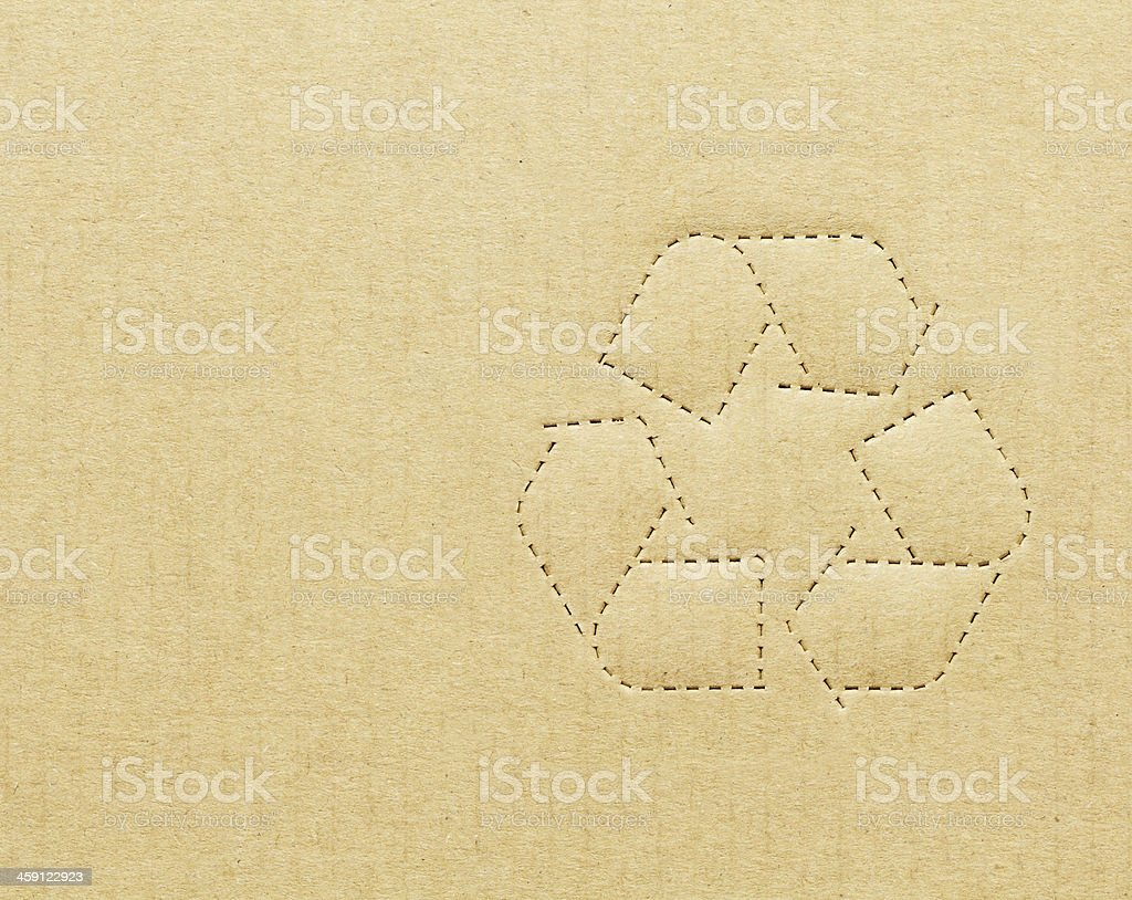 Recycling symbol on tan cardboard box stock photo