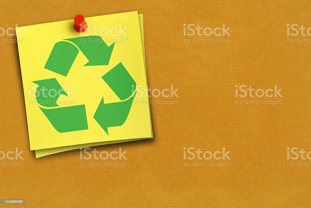recycling symbol on yellow note stock photo