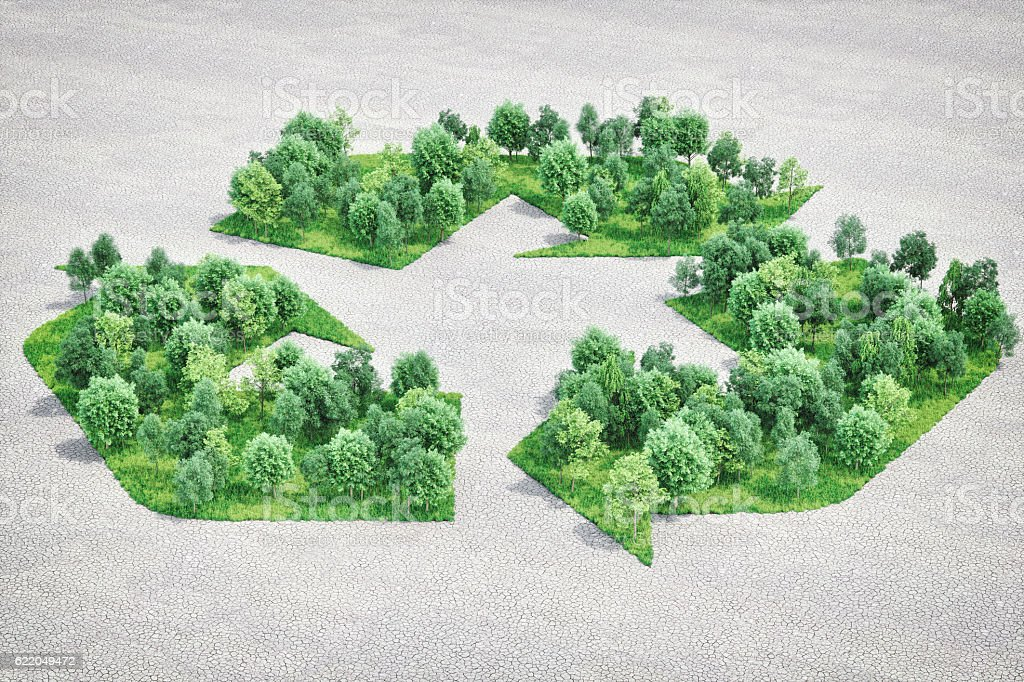 Recycling Symbol Shaped Forest In Arid Land stock photo