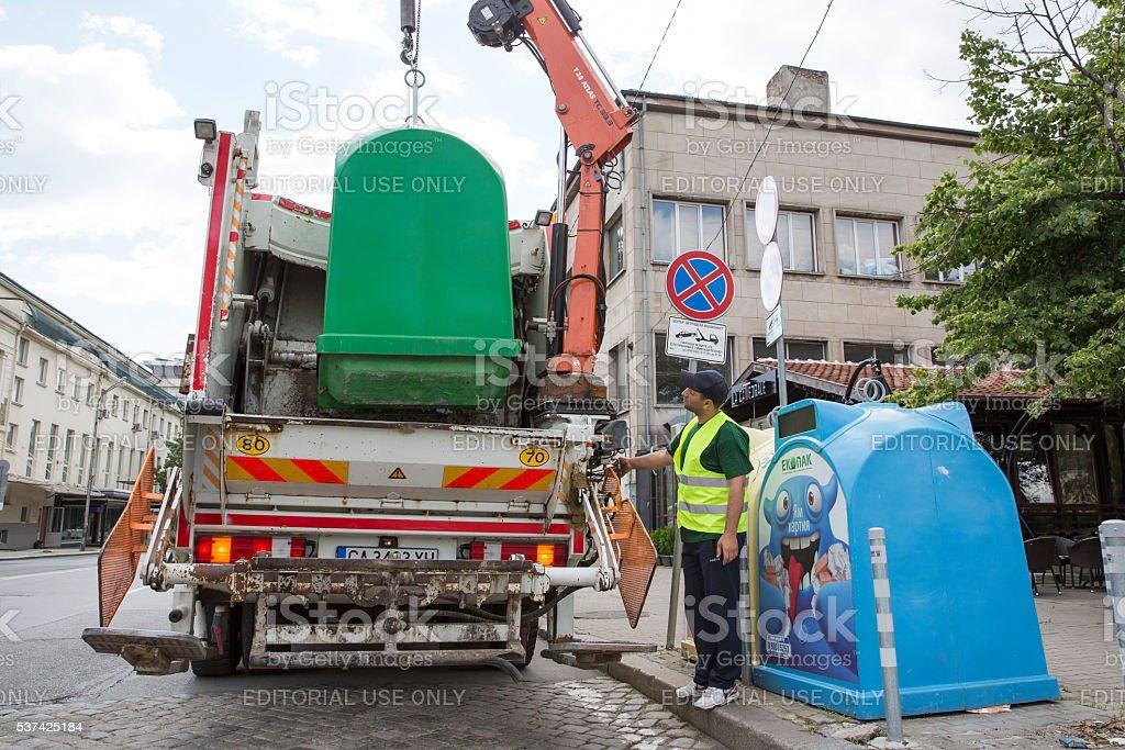 Recycling truck picking up trash bins stock photo