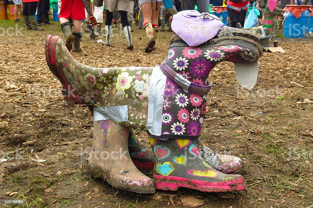 Recycling Wellington boots and duct tape dog sculpture stock photo