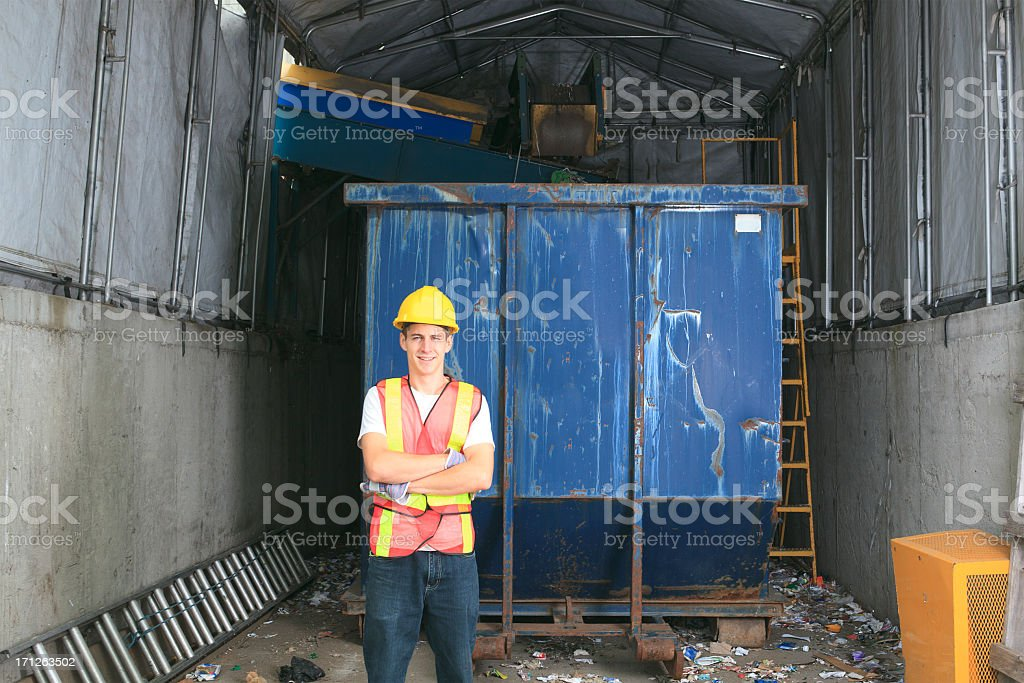 Recycling Worker - Tear stock photo