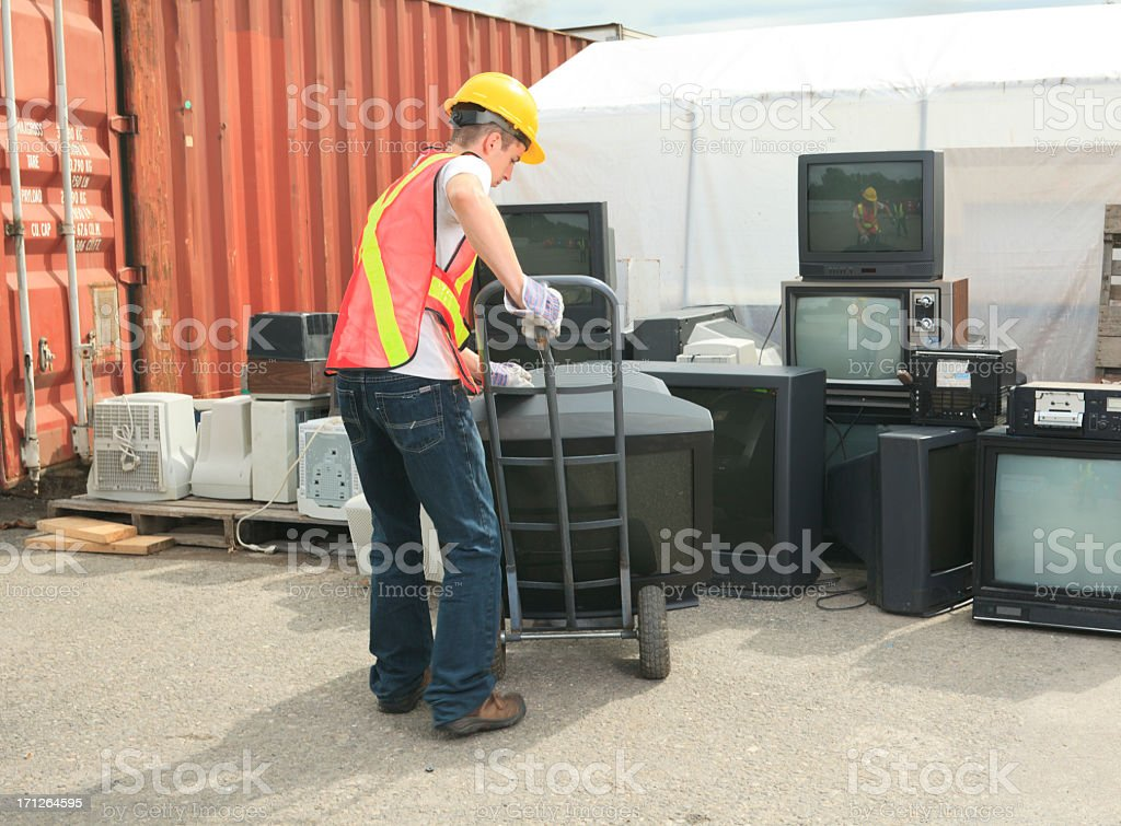 Recycling Worker - TV Electronic royalty-free stock photo