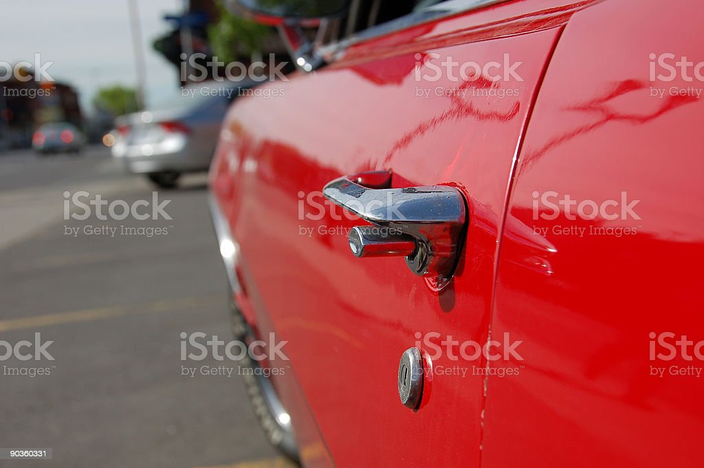 Red 1970 Vintage Car door handle royalty-free stock photo