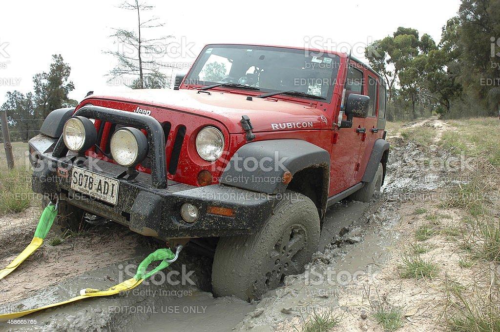 Red 2007 Jeep JK Wrangler Rubicon stuck mud, border track stock photo