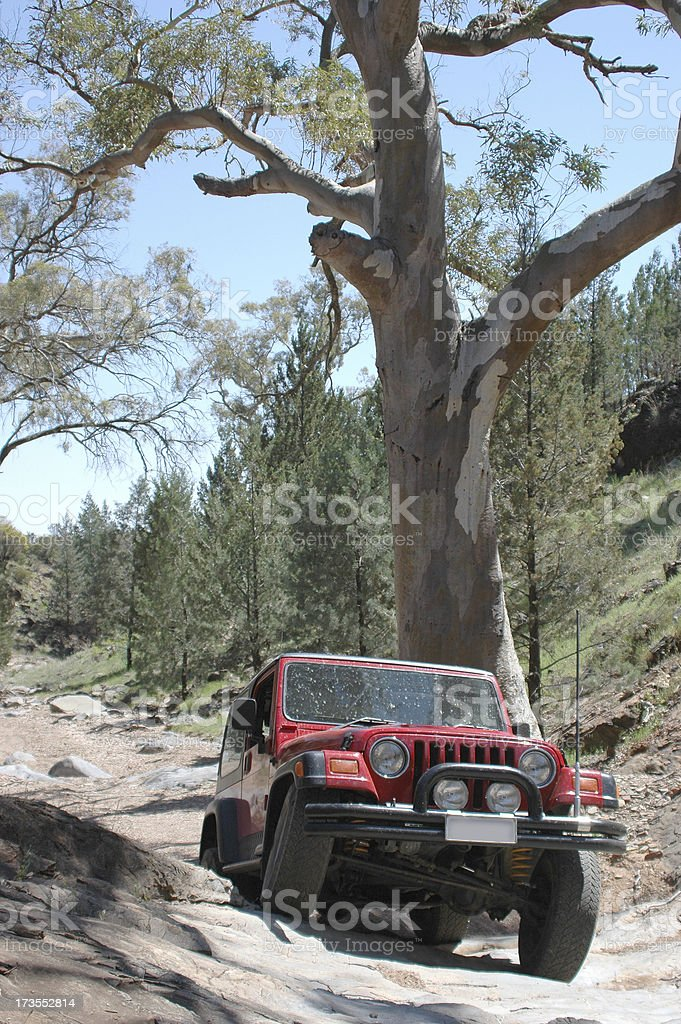 Red 4x4 rock crawling royalty-free stock photo