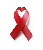 Red AIDS Awareness Ribbon Forming Heart  Shape On White Background