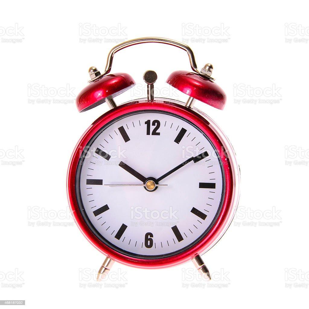 Red Alarm Clock. Isolated stock photo