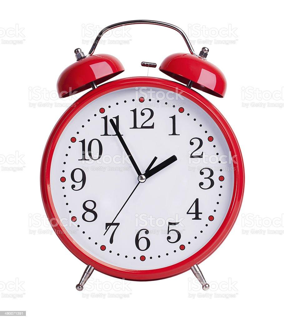 Red alarm clock on white background stock photo