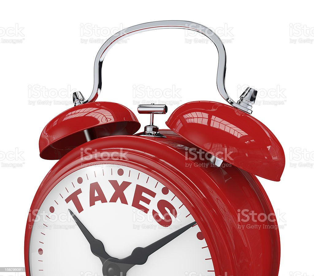 Red alarm clock with taxes written on it stock photo