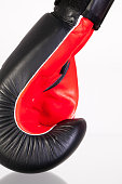 Red and black boxing gloves on a glass table