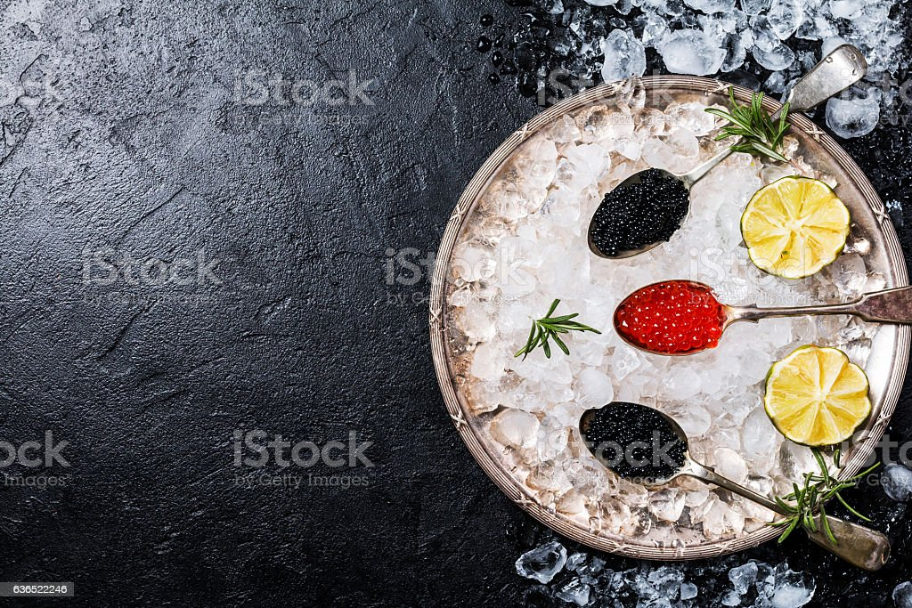Red and black caviar in spoons. stock photo