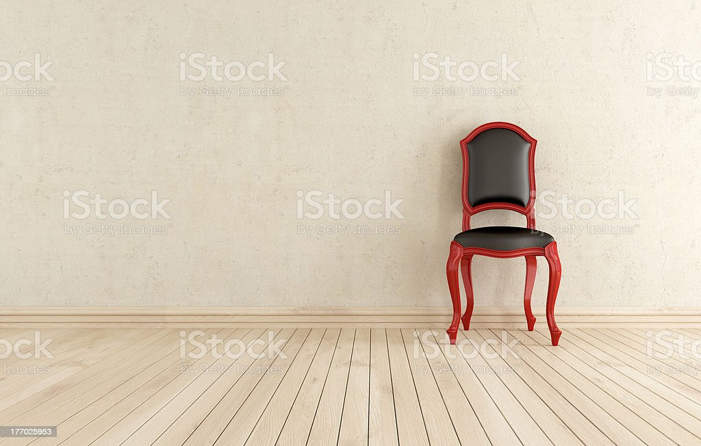 red and black classic chair against wall stock photo