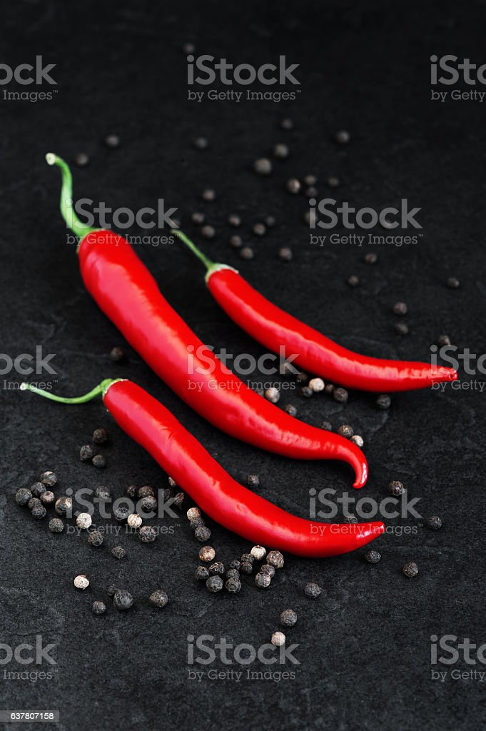 Red and black hot peppers stock photo