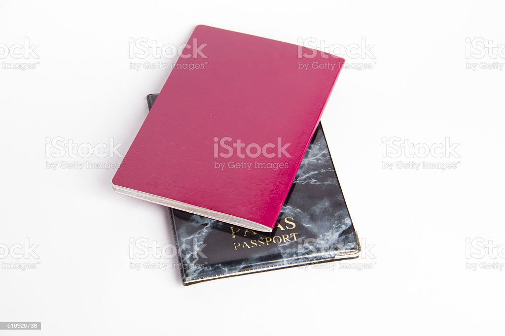 Red and black passports isolated stock photo