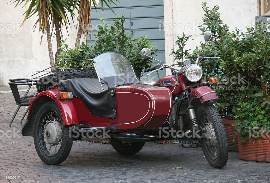 Red and Black Retro Motorcycle with Sidecar Combination stock photo