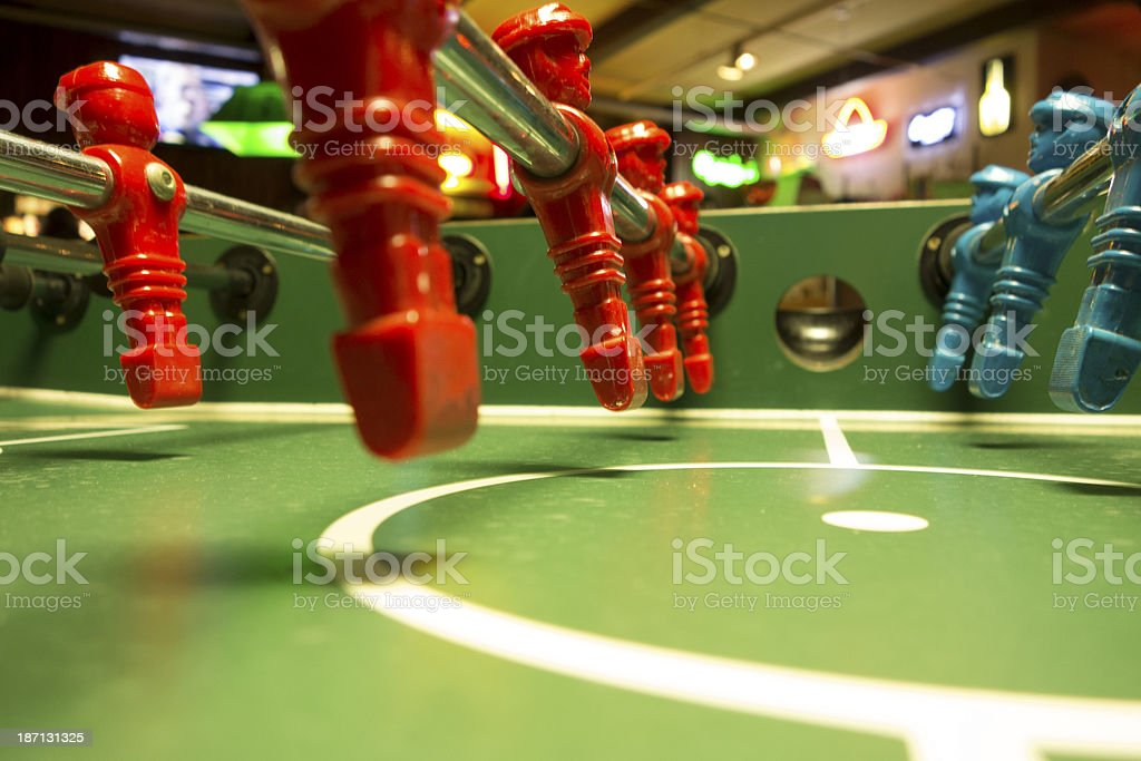 red and bllue Foosball players in a row stock photo